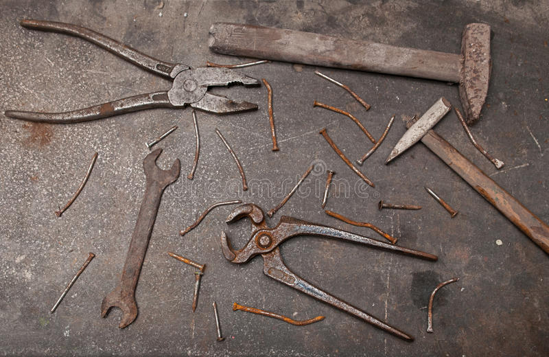 Workbench with rusty tools royalty free stock images