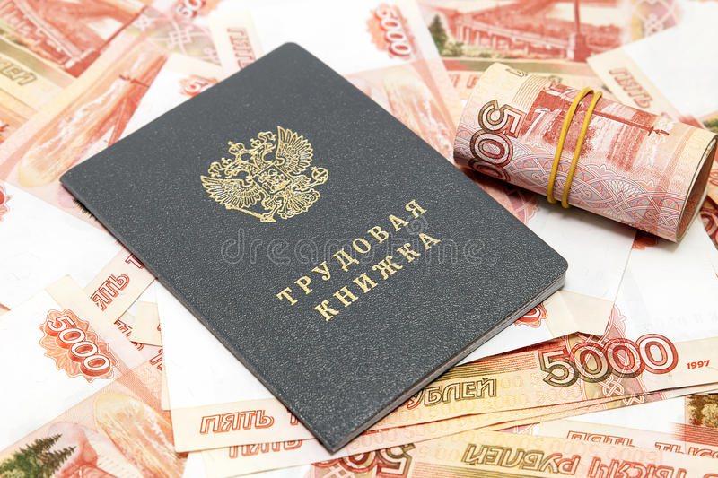 Workbook and money Russian. / Russian translation for: labor book royalty free stock photography