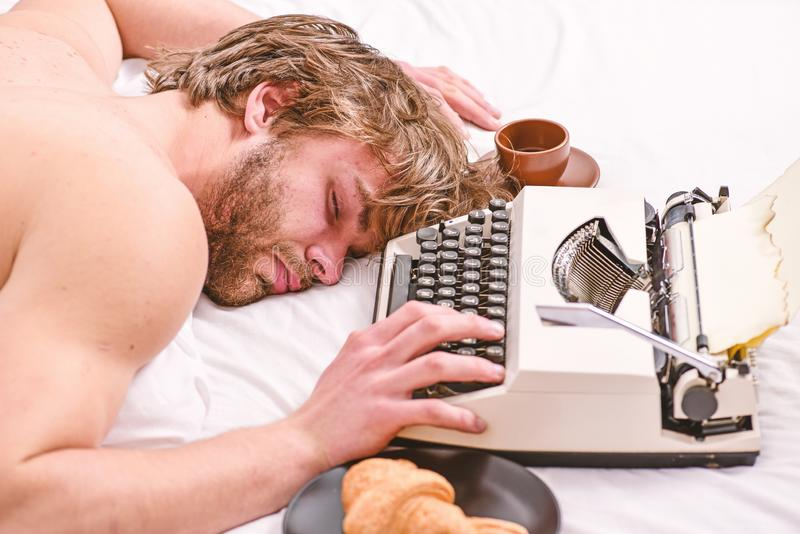 Worked all night. Man fall asleep. Writer used old fashioned typewriter. Author tousled hair fall asleep while write. Book. Workaholic fall asleep. Man with stock photography