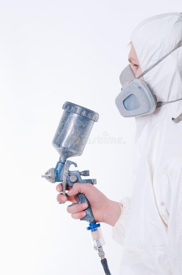 Worker with airbrush gun. Studio shot stock image