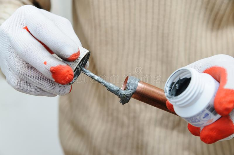 A worker is applying flux. stock photo