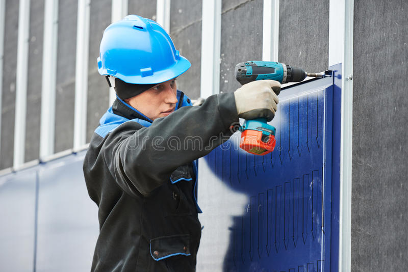Worker assembling facade metal construction royalty free stock photo