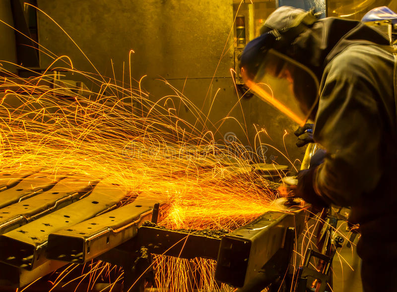 Worker in automotive industry movement work grinding parts royalty free stock photography