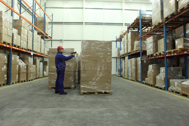 Worker with bar code reader royalty free stock photos