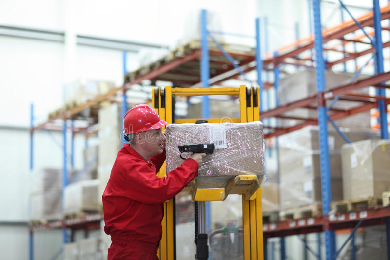 Worker with bar code reader working in warehouse stock photos