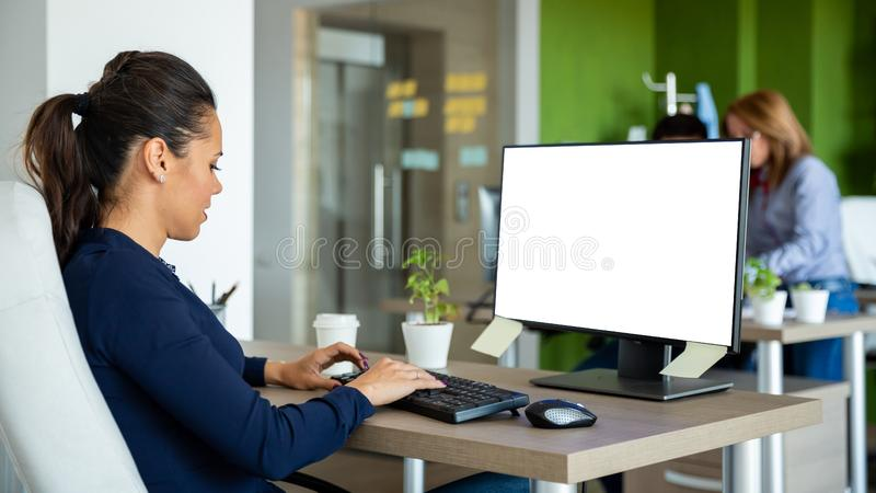 Worker from the beginning writing something on the computer royalty free stock image