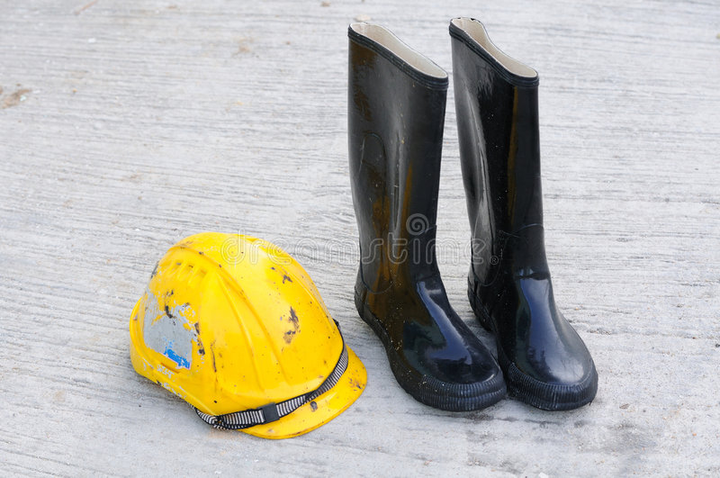 Worker boots and hardhat royalty free stock images