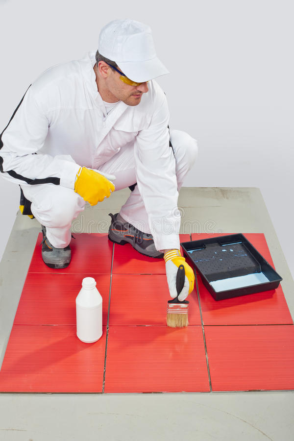 Worker Brush Primer Joints Of Red Tiles Stock Photos