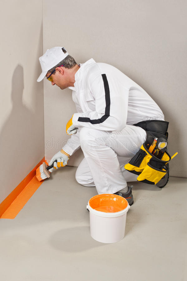 Download Worker brush waterproofing stock photo. Image of construction - 26949656