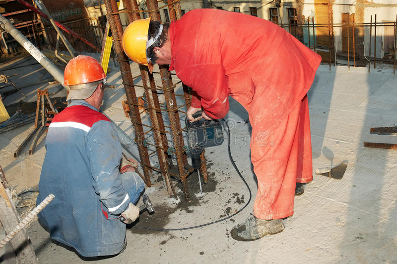 Download Worker Builder Drill And Concrete Stock Photo - Image: 14448746