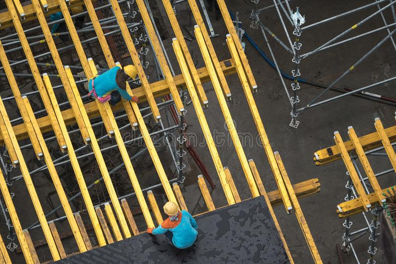 Worker Building component structure of the building. 1 stock images