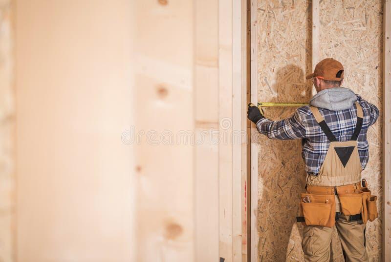 Worker Building Interior Walls. Industrial Theme. Construction Contractor Building Residential Interior Walls stock photos