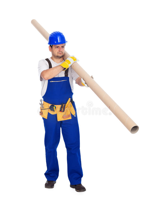 Worker carries long pipe royalty free stock photo