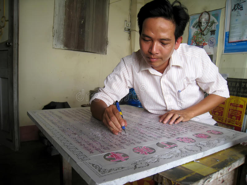 Worker carving stela stone. HAI DUONG, VIETNAM, July, 24: Worker carving stela stone in his shop on July, 24, 2013 in Hai Duong, Vietnam royalty free stock photo
