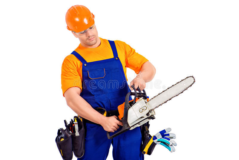 Worker with chainsaw stock images