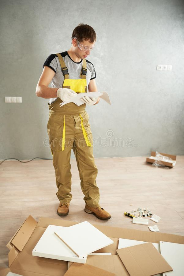 Worker checking instruction stock photo