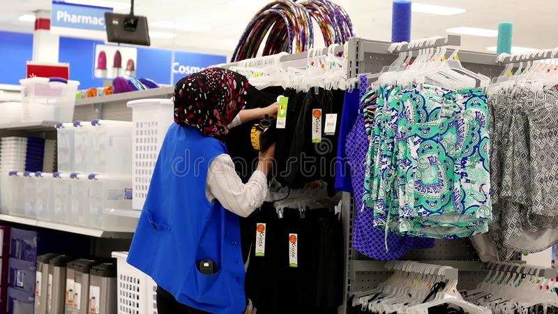 Delightful Worker Checking Price Tag For Display Clothes On Sale Stock Footage   Video  Of Display, Beauty: 74471828