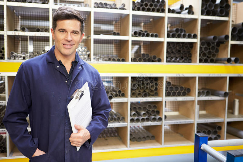 Worker Checking Stock Levels In Store Room royalty free stock images