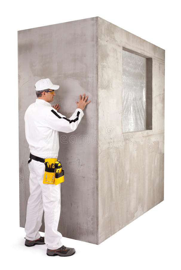 Worker checking the surface. Worker checking the smoothness ot cement surface stock image