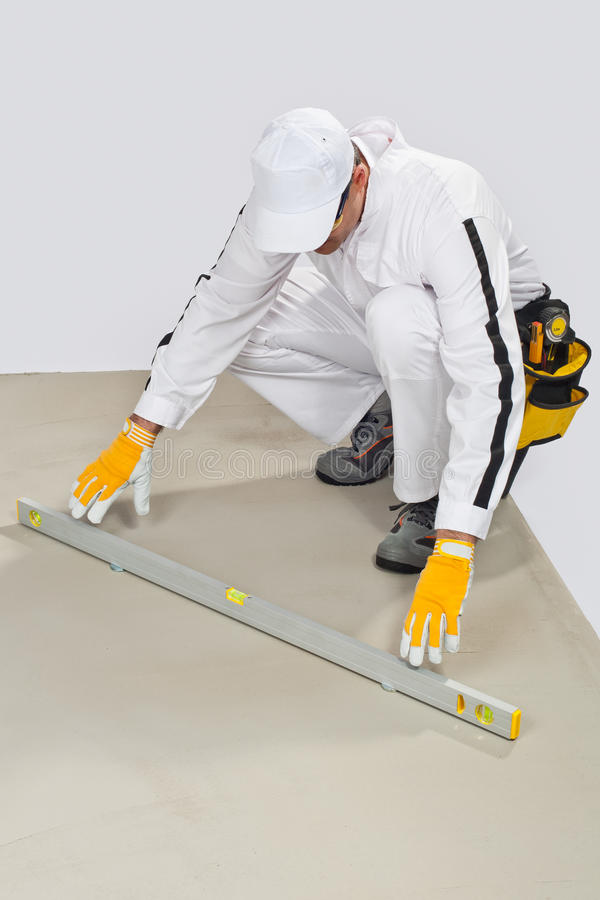 Download Worker Checks Cement Base Levels Stock Photo - Image: 27137808