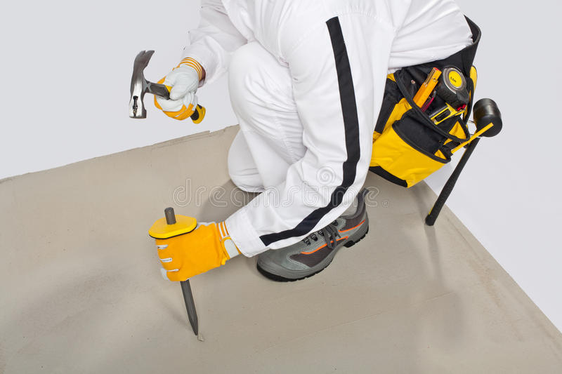 Worker with chisel check concrete base