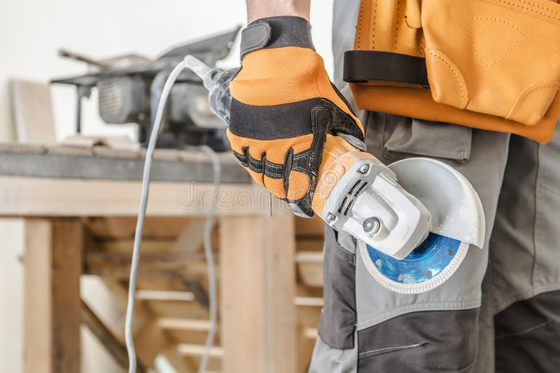 Worker with Circular Saw. Worker with Small Circular Saw in Hand. Small Remodeling Works Inside Apartment royalty free stock images