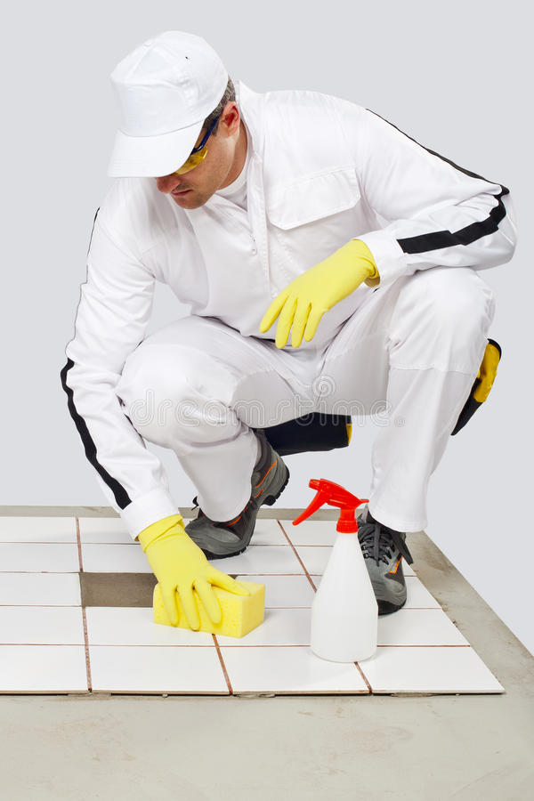 Download Worker Cleans With Sponge And Spray Old Tiles Royalty Free Stock Image - Image: 25671366