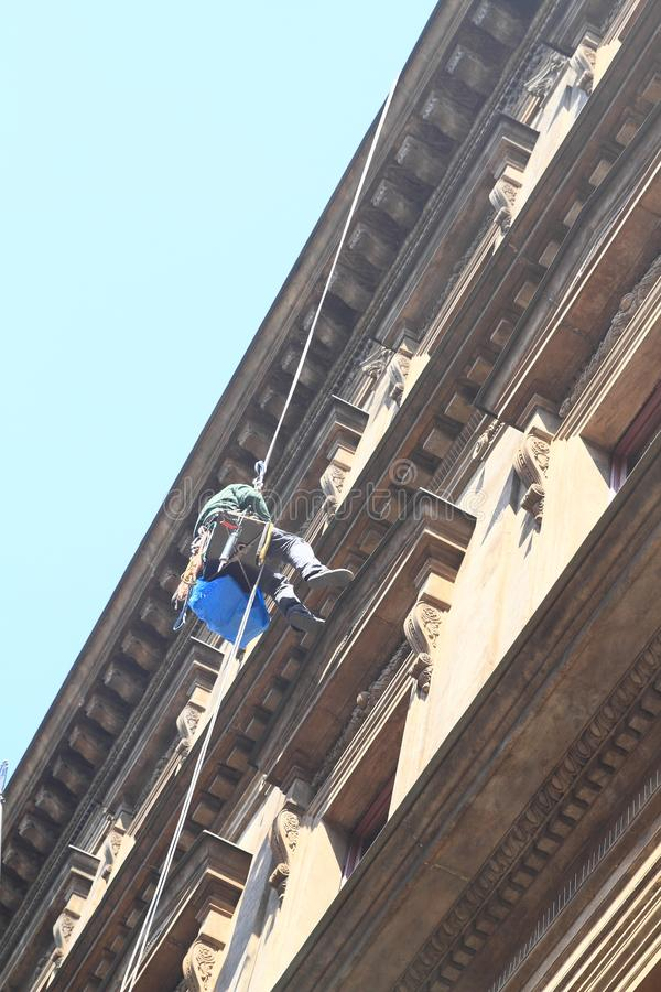 Worker - Climber cleaning facade and windows royalty free stock images