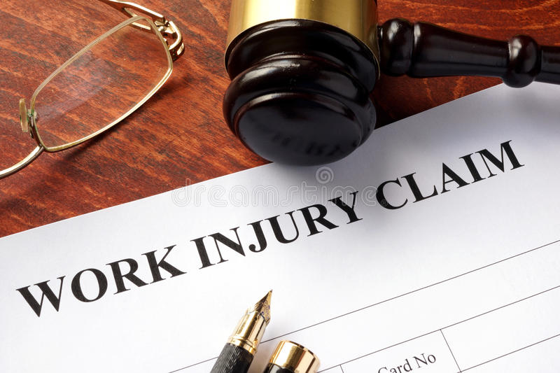 Worker compensation. Work injury claim on a table stock photos