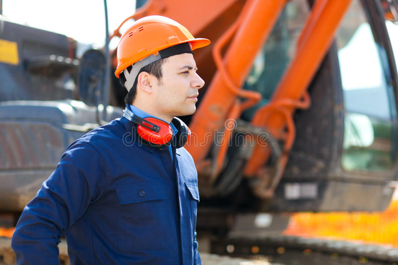 Worker in a construction site royalty free stock image