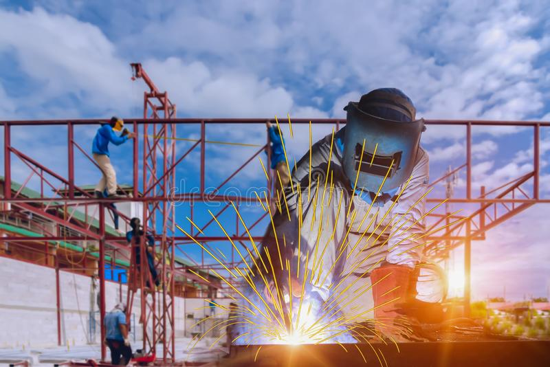 Worker construction welder man welding at site. royalty free stock images