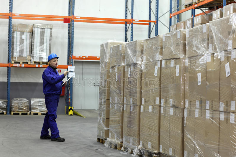 Worker counting stocks in warehouse stock photos