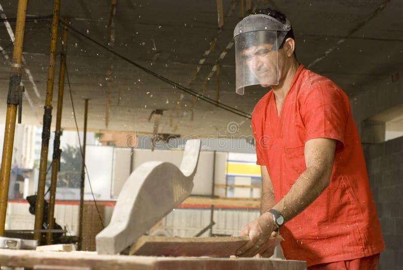 Worker Cuts Board - Horizontal royalty free stock photo