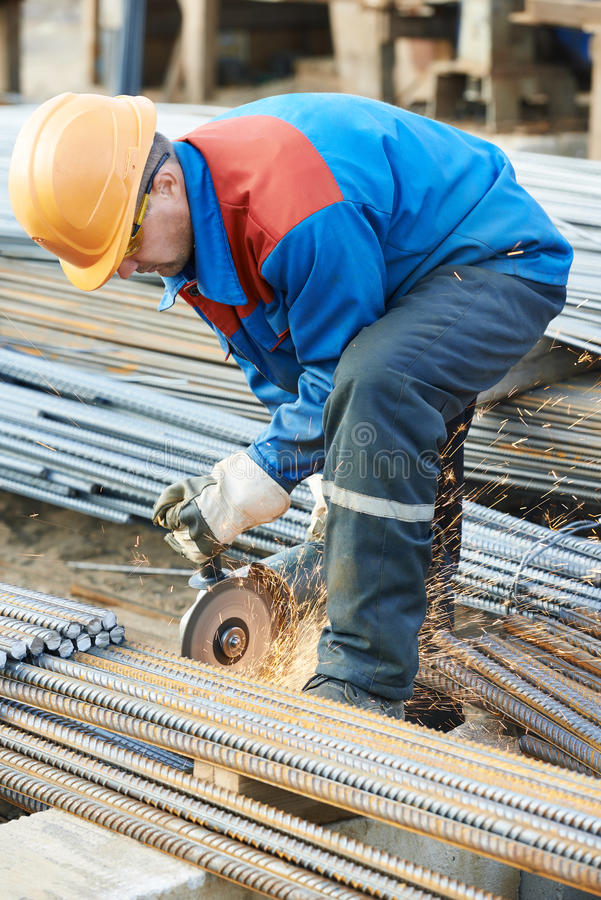 Buildings In A Cement Grinding Mill : Worker cutting rebar by grinding machine stock image