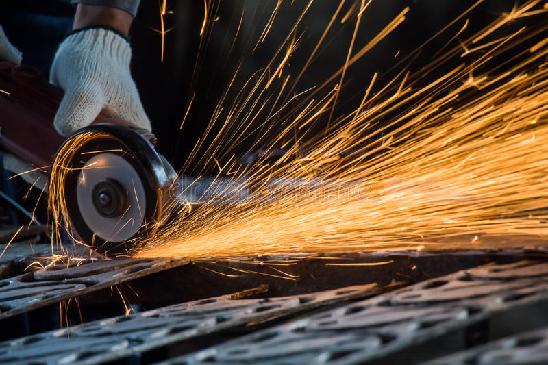 Worker cutting steel stock images