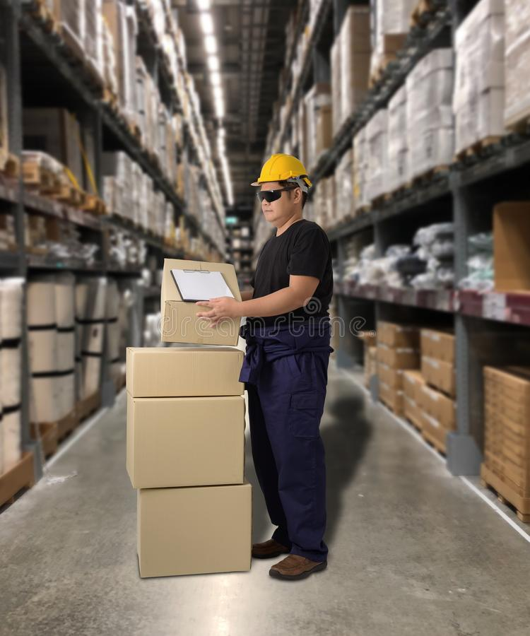Worker Delivering products Sign the signature on the product receipt form with parcel boxes. Blurred the background of the warehouse stock images