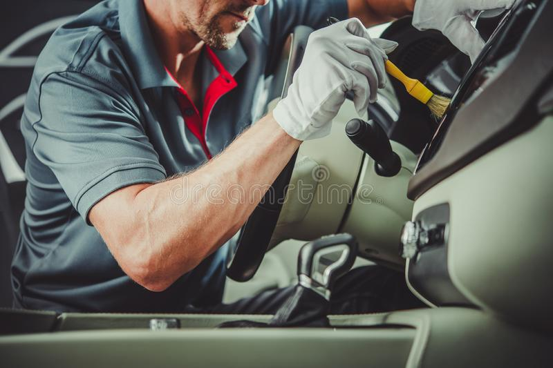Worker Detailing Car Interior. Caucasian Automotive Industry Worker Detailing Car Interior. Vehicle Cleaning Maintenance stock image