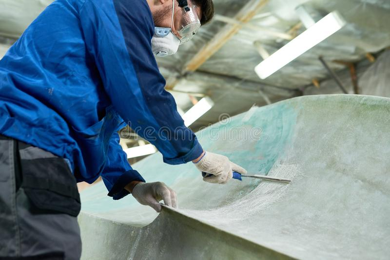 Worker Doing Boat Repairs royalty free stock image