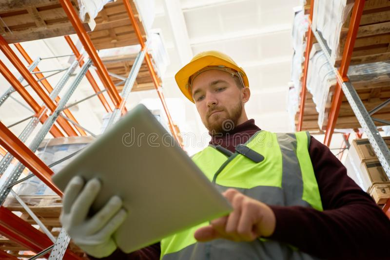 Worker Doing Inventory in Warehouse royalty free stock photo
