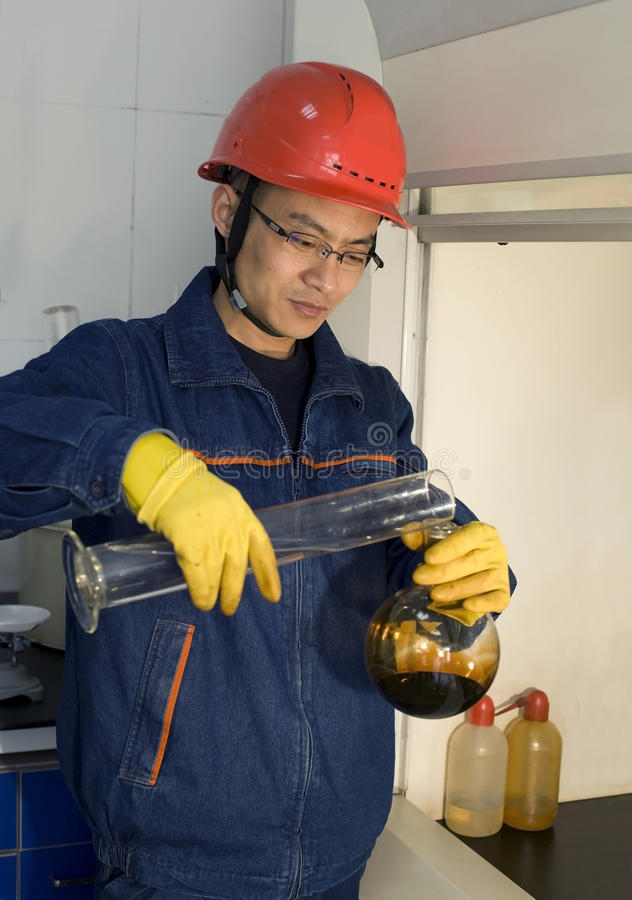 The worker is doing testing in laboratory