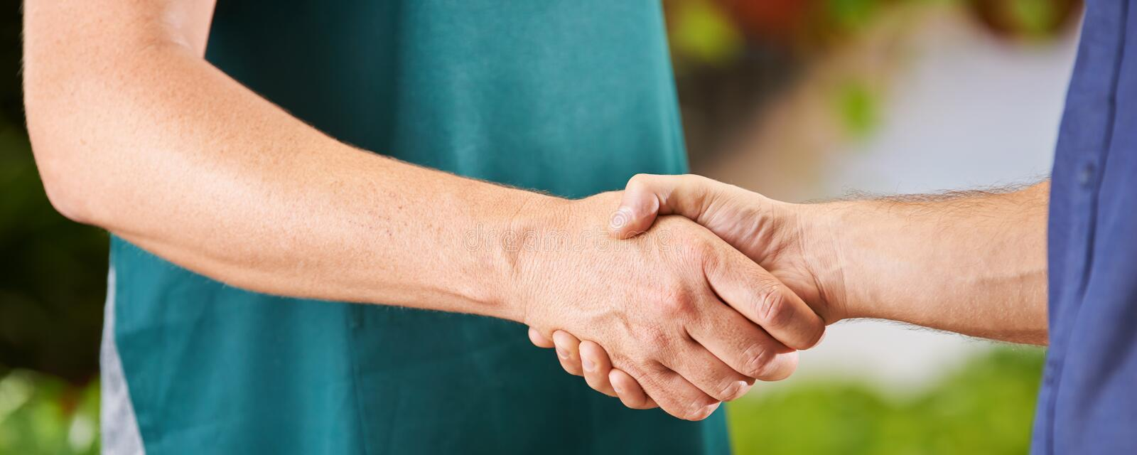 Worker doing welcome shakehands royalty free stock photos