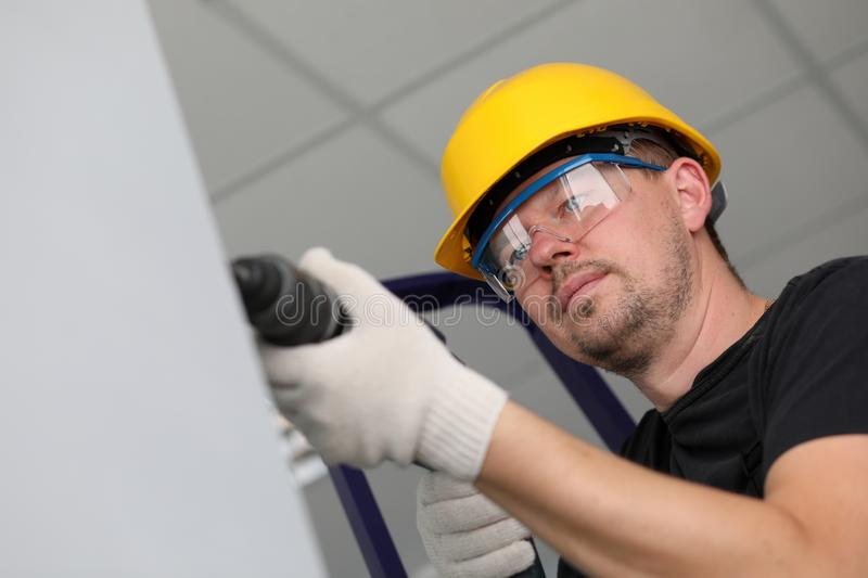 Worker with drilling machine stock photos