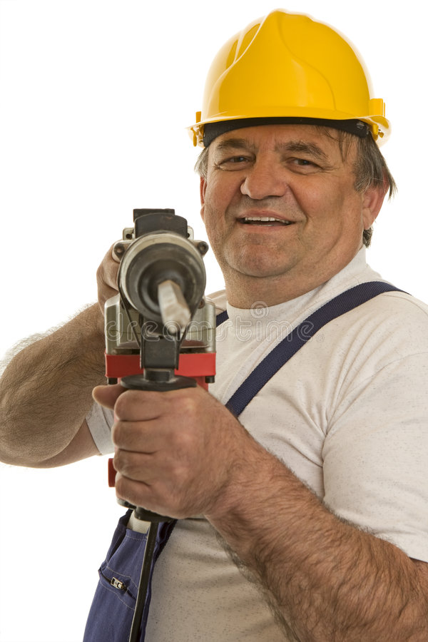 Worker with drilling machine and safety helmet. Isolated against a white background stock images