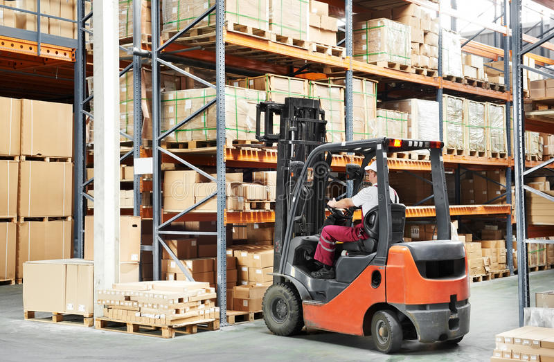Worker driver at warehouse forklift stock image