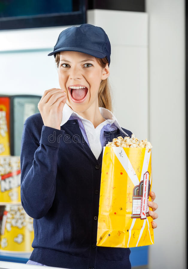 Worker Eating Popcorn At Cinema Concession Stand Stock Image - Image ...