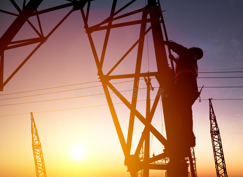 Worker at an electric substation royalty free stock photography