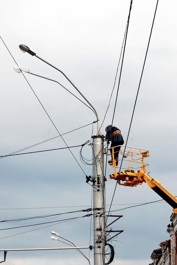 Worker-electrician repairing the wires royalty free stock images