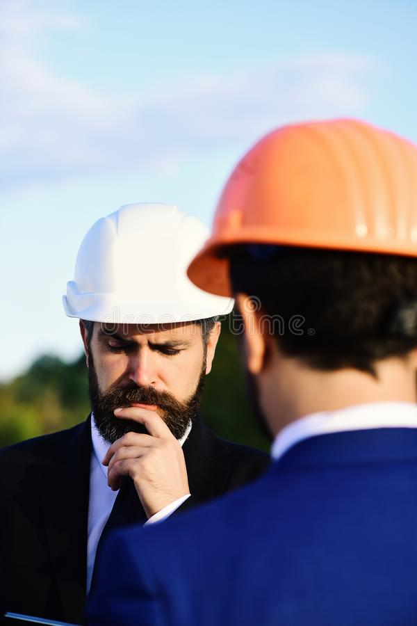 Worker and engineer hold meeting. Architect with puzzled face stock photos