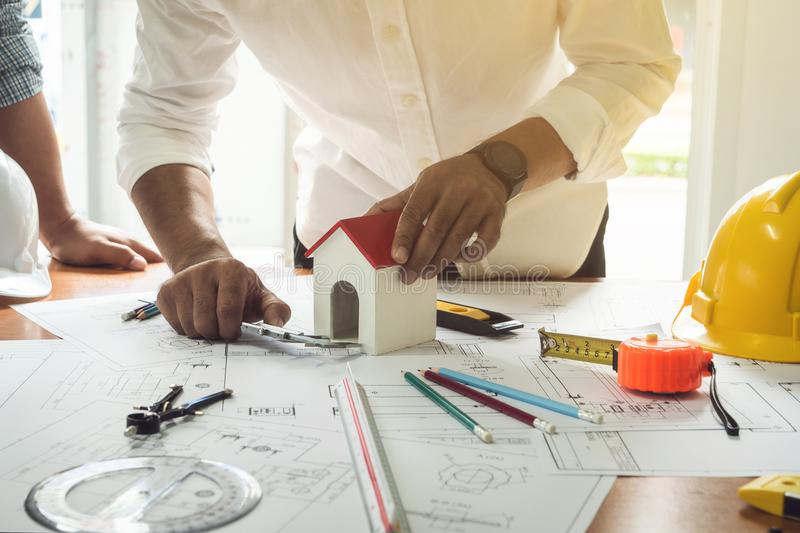Worker engineer housing plan architect drawing paper of structure. royalty free stock images