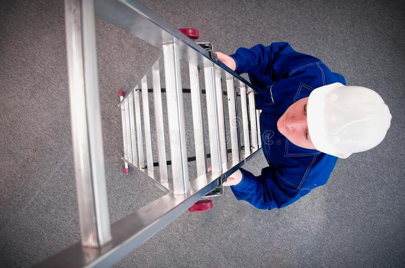 Worker enters the ladder royalty free stock images